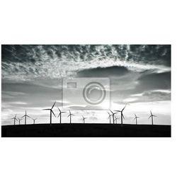 Obraz Sylwetki turbin wiatrowych przeciwko dramatycznego chmury