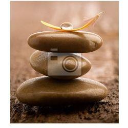 Fototapeta Stos kamienie brązowe masażu na tle drewniane