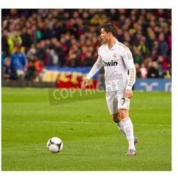 Fototapeta BARCELONA - JANUARY 25: Cristiano Ronaldo of Madrid in action during the Spanish Cup match between FC Barcelona